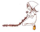 座り込んでお花を編む女の子