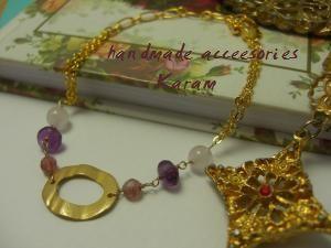 ゴールド、ピンク系のブレスレット