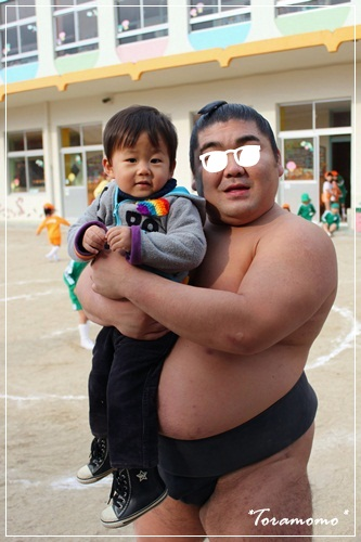 お相撲さんと龍