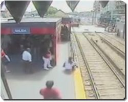Mother Allowing Child On To Rail Line As Train Comes In To Station
