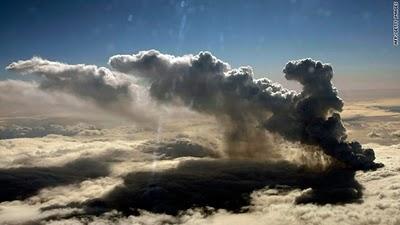 Smoke billows from an erupting